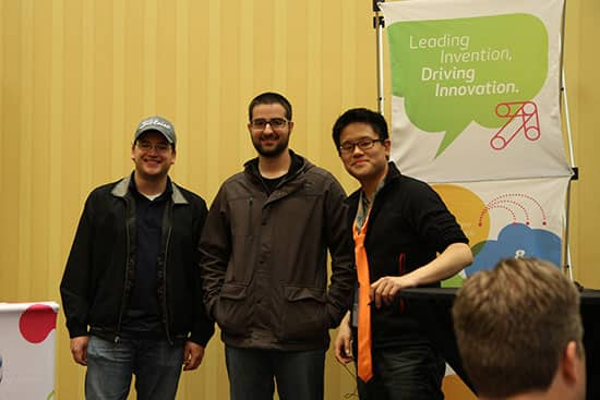 Alex Donn, mastermind behind AT&T Hackathons, congratulates the developers of Round Trip on their third place win. (photo courtesy of AT&T)