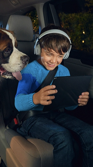 Dog and boy with tablet